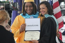 Image of graduating students holding a diploma
