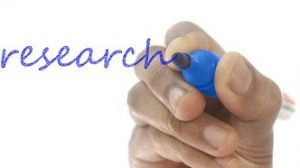 worth it to study further? - image of someone writing the word 'research'