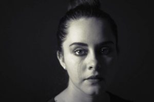 Suicide is not the answer - black and white image of a girl crying