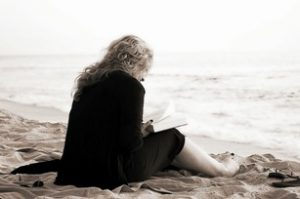 how not to lose your study interest image of a woman reading on a beach