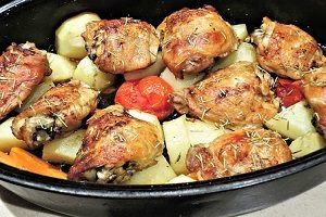 An image of chicken and vegetables in a pan