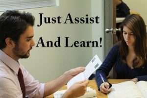 "How to not be taken advantage of during teaching practice image of the words ""Just Assist And Learn"" written on an image of a student teacher assisting a teacher"